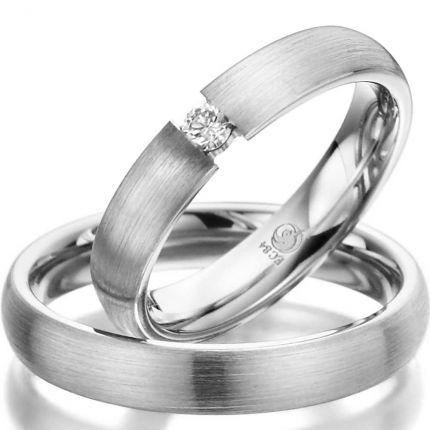 Ringpaar aus Weißgold mit Spannring