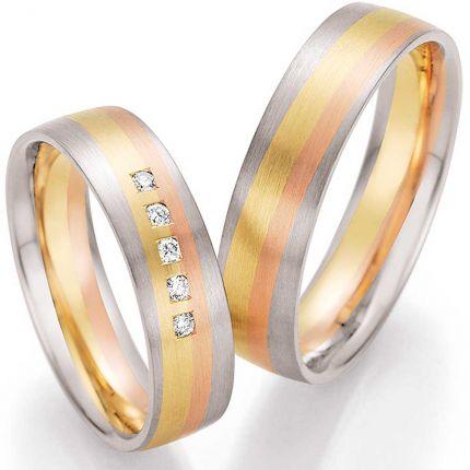 Hochzeitsringe mit dreifarbigem Gold wie ein Sonnenaufgang