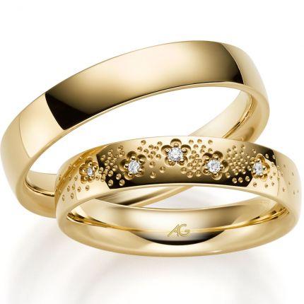 Funkelnde Ringe aus poliertem Gelbgold mit 5 Brillanten