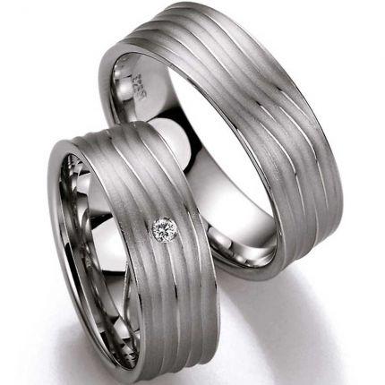 Eheringe aus Silber und schwungvollem Wellenprofil