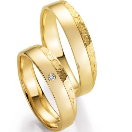 Hochzeitsringe mit ausdrucksstarkem Design, besonderer Oberflächenstruktur und Brillant
