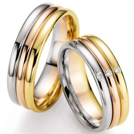 Drei Ringe bilden einen tollen Ehering. Rotgold/ Weissgold / Gelbgold mit drei Brillanten, hochglanz