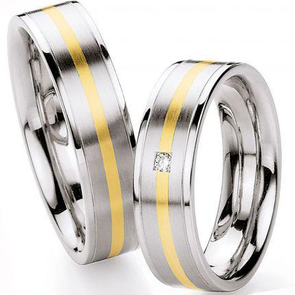 Hochzeitsringe aus Edelstahl und Gold mit einem Brillant