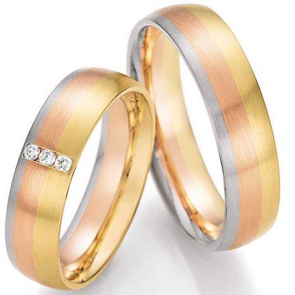 Hochzeitsringe aus Gelbgold mit innovativem Farbverlauf und Brillanten