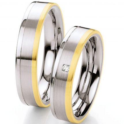 Tolles Ringpaar aus Edelstahl mit Gold und Brillant