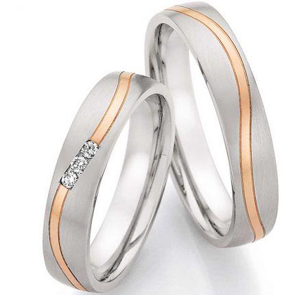 Ringpaar aus Edelstahl mit Roségold und drei Brillanten