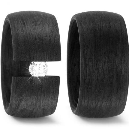 Breite schwarze Trauringe aus wahlweise mit großem Brillant in Spannringoptik