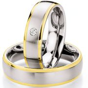 Hochzeitsringe aus Edelstahl und Gelbgold mit Brillant