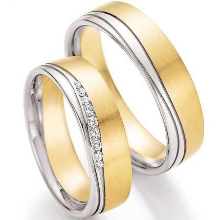 breite Hochzeitsringe aus Gelb,- und Weißgold mit geschwungener Fuge