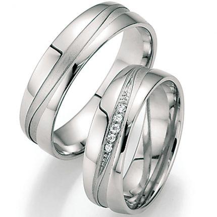 Trauringe aus Silber mit Brillantverlauf und Wellenfuge