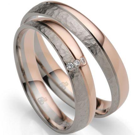 Funkelndes Ringpaar aus Weißgold und Roségold mit wellenförmiger Fuge und 3 Brillanten
