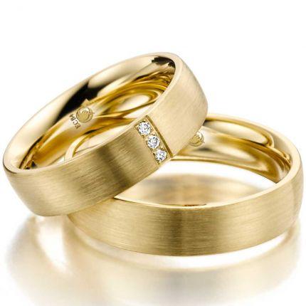 Massive Ringe aus Gelbgold mit drei Brillanten
