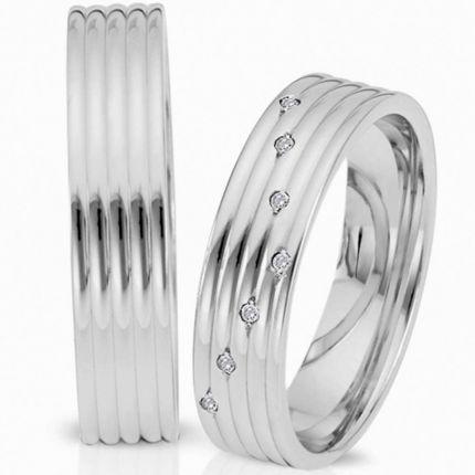 Edle Ringe aus poliertem Silber, in elegantem Design und wahlweise 7 Brillanten oder Zirkonia