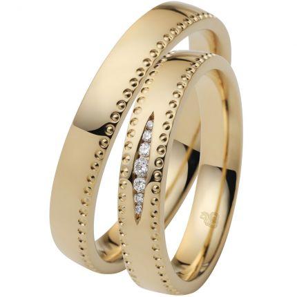 Romantisches Ringpaar aus Gelbgold mit Millgriff Rand und 7 Brillanten