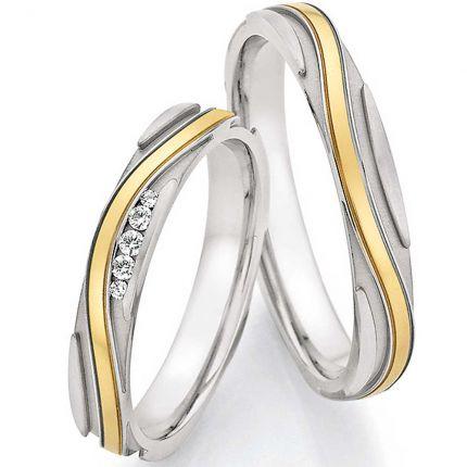 Tolles Ringpaar aus Edelstahl mit geschwungenem Goldband
