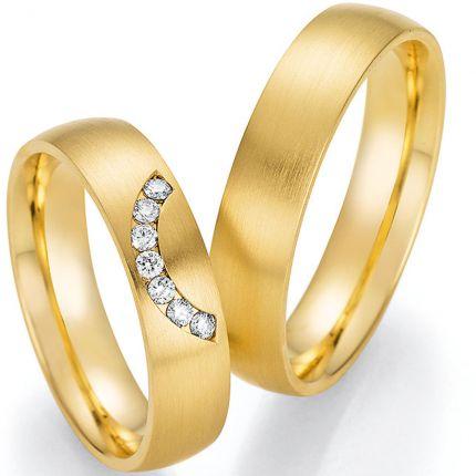 Hochzeitsringe aus Gelbgold mit Brillantbogen im Damenring