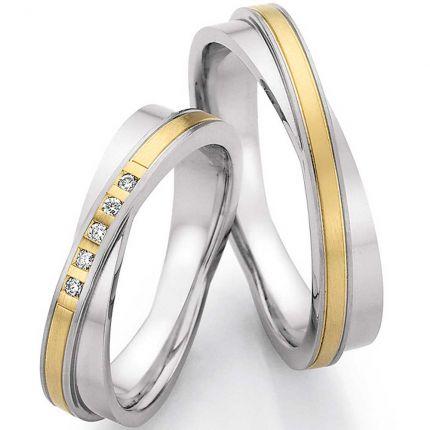 Außergewöhnliches Ringpaar aus Edelstahl mit 585 Gelbgold