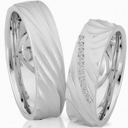 Ringe aus mattem Silber mit wellen Profil und wahlweise mit bis zu 10 Brillanten oder Zirkonia