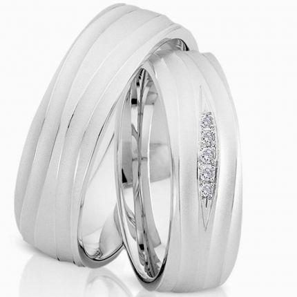 Schöne Ringe aus mattem Silber mit dynamischen Wellenprofil und wahlw. 5 Brillanten oder Zirkonia
