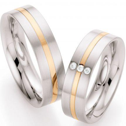 Hochzeitsringe aus Edelstahl und Rotgold mit Brillanten