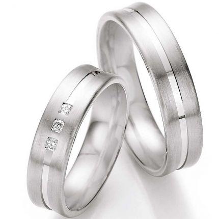 Bezaubernde Trauringe in toller Form mit hochglanz-Fuge und 3 Brillanten in einem Ring