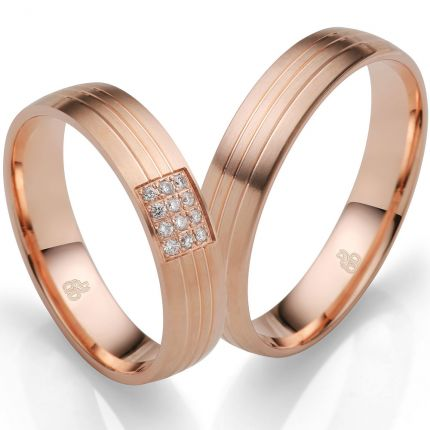 Edles Ringpaar aus Rotgold mit 9 Brillanten in einem Ring