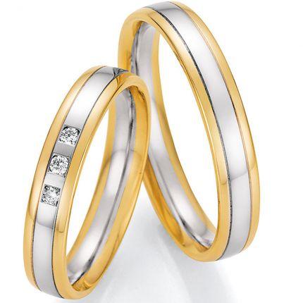 Traumhafte zweifarbige Eheringe aus Weißgold mit 3 Brillanten und Rändern aus Gelbgold