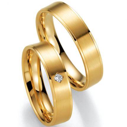 Schöne Eheringe aus Gelbgold mit Brillant