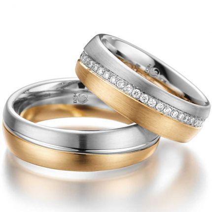 Zweifarbige Ringe mit diagonalem Brillantkranz